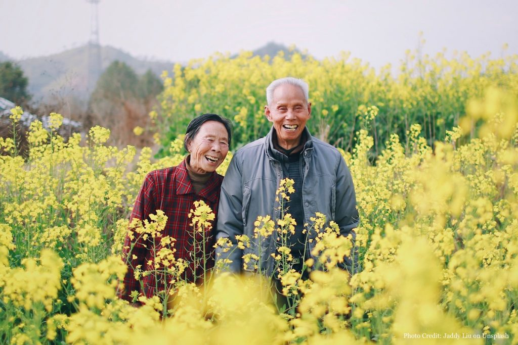 Older Adults Smiling in Field