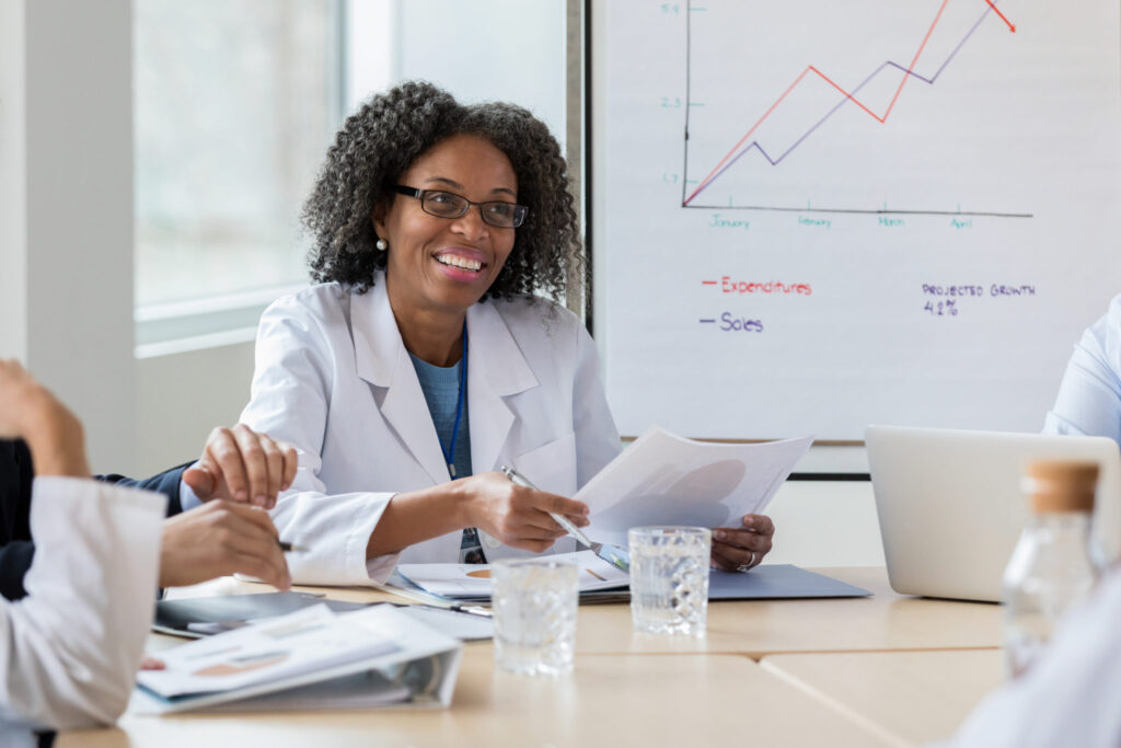 Woman physician leading a meeting