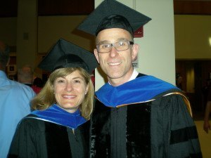 Professors De Vivo and Kraft get ready to march in the commencement ceremony.