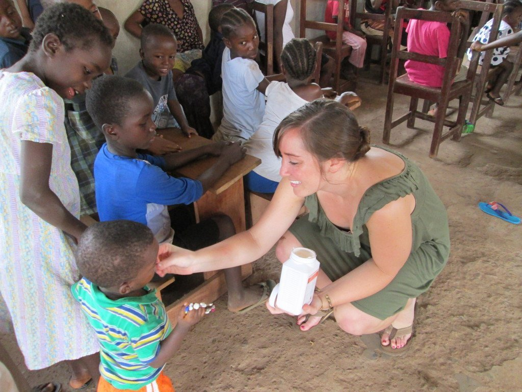 Natalie giving out de-worming tablets at an orphanage over the weekend