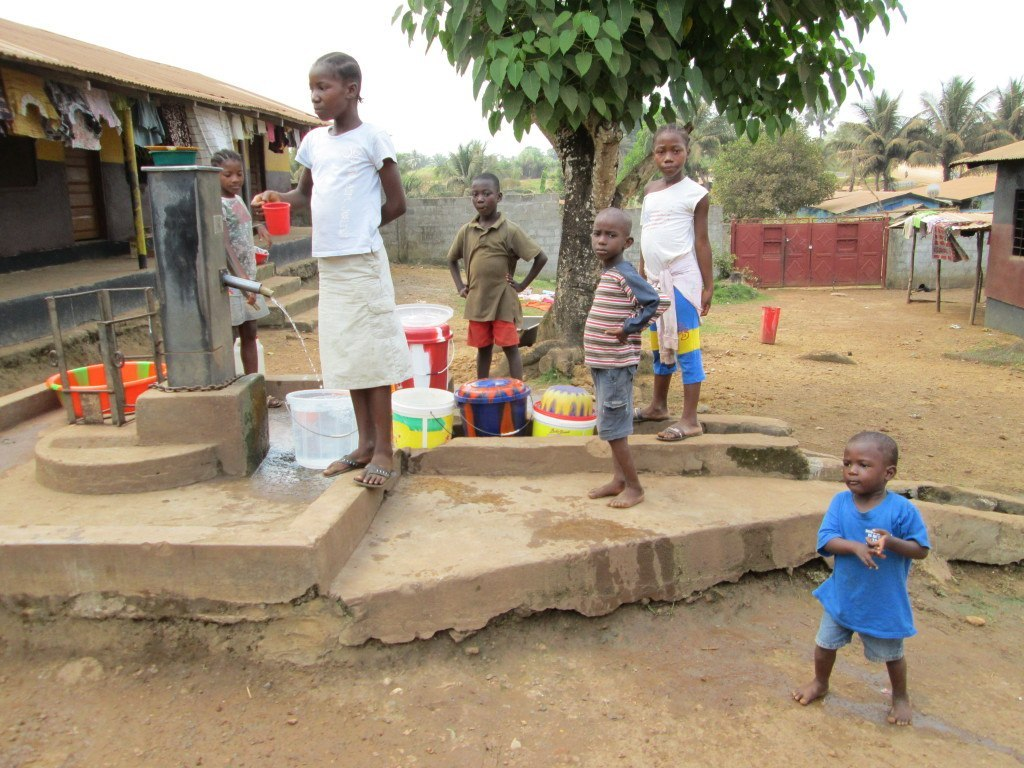 Local children getting water in the neighborhood