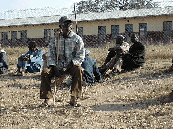 Older man sitting outside in rural South Africa