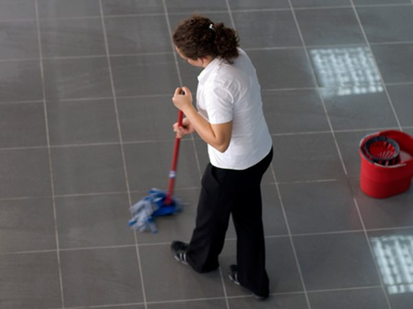 A woman mopping a floor
