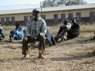 Older man in South Africa sitting in a field