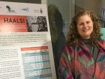Research Scientist Elyse Jennings standing next to her poster