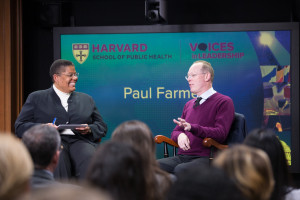 Paul Farmer speaks at Voices in Leadership. Michelle Williams moderated.
