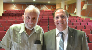 Richard Levins with South American academic intellectual in lecture hall