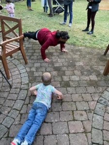 Lissah and Rowan seeing who can do more pushups.