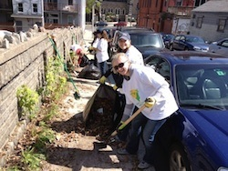HSPH volunteers Caitlin O'Connor (front) and Jen Doleva clean Pontiac Street in Mission Hill.