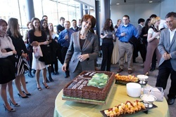 Laurie Glimcher, center, is surprised with a cake marking her 30 years of contributions to science.