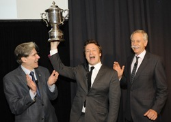Jamie Oliver hoists the Healthy Cup as Dean Julio Frenk (l) and Prof. Walter Willett look on.