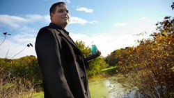 Ramon Sanchez, SD '11, holds a flask filled with algae—a potential source of biofuel.