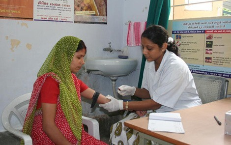 An expectant mother has blood drawn at a clinic in Ahmedabad, India