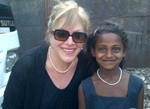 Vice Dean Ellie Starr with a young resident of the Kaula Bandar slum community in Mumbai.