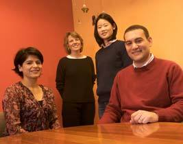 TEAM TB  Exploring drug-resistant disease are (left to right) Mercedes Becerra, an HSPH alumna and former doctoral student who is now an assistant professor of social medicine at Harvard Medical School and a research scientist with Partners in Health; Sarah Fortune, HSPH assistant professor of immunology and infectious diseases; Christie Jeon, a doctoral student at HSPH; and Ted Cohen, an HSPH alumnus and former postdoctoral fellow who is now an assistant professor of medicine at Harvard Medical School and an associate scientist at Brigham and Women's Hospital Division of Global Health Equity. Cohen and Jeon trained with the group's lead researcher, Megan Murray, an associate professor of epidemiology at HSPH.