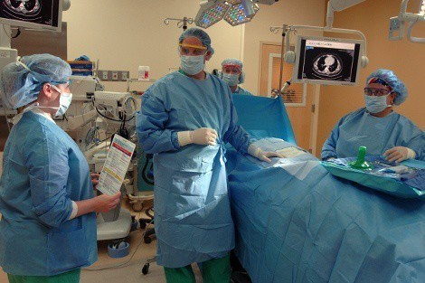 Surgeon and HSPH student Scott Ellner (center) and colleagues review a safe surgery checklist
