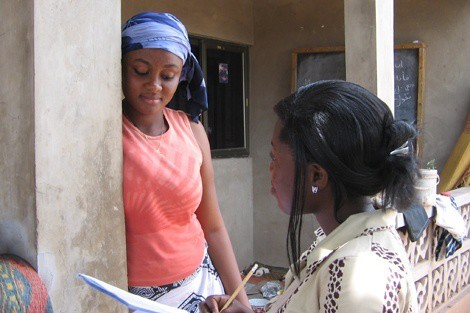 An interviewer invites a woman to participate in the Women's Health Study of Accra