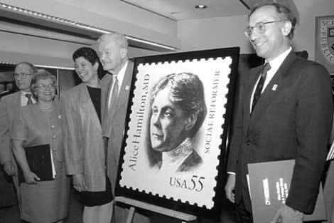 In 1995, the United States Postal Service dedicated a postage stamp in recognition of Alice Hamilton's achievements. Here she is honored by then-Harvard School of Public Health Dean Harvey V. Fineberg and others.
