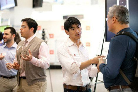 HSPH student Fah Sathirapongsasuti (second from right) and other members of Team SQ describe their project at the Dean's Challenge Demo Day on May 22.