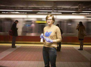 Catherine Baranowski, PhD '18, swabs surfaces on Boston'sMBTA subway system, in a project that explores whetherhuman microbial communities are transferred in well traveled public places.