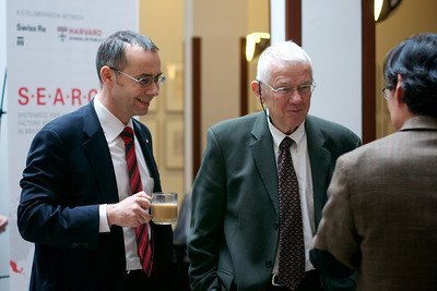 (L-R) Felix Moesner, consul, director, Swissnex Boston, and Joseph Brain chat with Frank Hu at the conference.