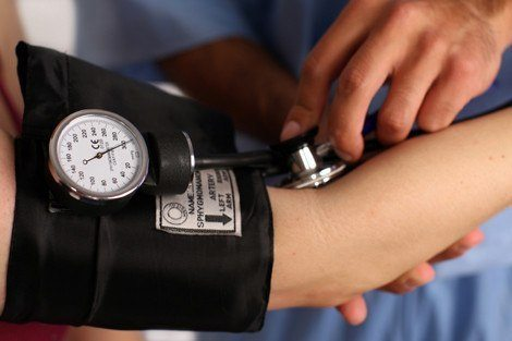 Medical worker checking blood pressure