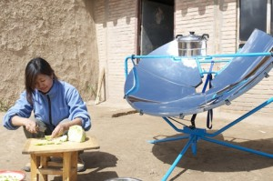 Woman in Qinghai,China preparing noodle soup