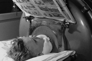 Patient in an iron lung