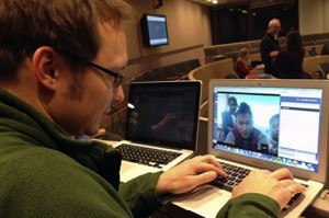 HSPH student Phil Summers video chats with PHI student Saw Htei Too