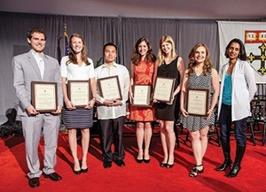 At this year's graduation, HSPH members of the twinning course received the James H. Ware Award for Achievement in the Practice of Public Health. (From left) Corey Peak, SM '14; Kelsey Gleason, SM '14; Jean Nepomuceno, MPH '14; Rachel Whelan, SM '14; Julia Hellman, MPH '14; Courtney Cox, SM '14; Parveen Parmar, instructor and Harvard Humanitarian Initiative associate faculty member. Not pictured: Phillip Summers, MPH '14, and Jami King, SM '15.