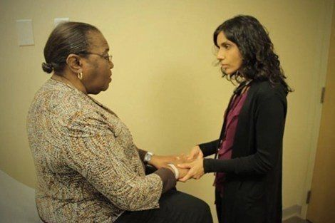 Monica Bharel, MPH '12, (right) with a patient