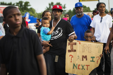 Demonstrators protest outside of Greater St. Marks Family Church in Ferguson, Missouri August 14, 2014. REUTERS/Lucas Jackson