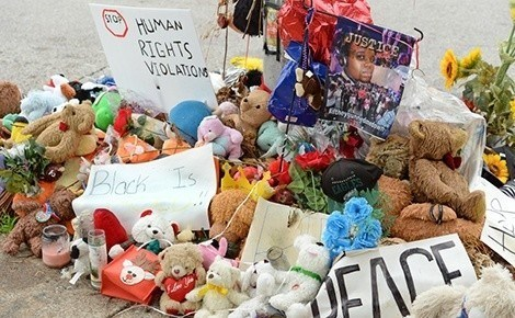 A makeshift memorial near where teenager Michael Brown was shot to death by police in Ferguson, Missouri