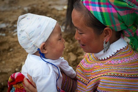 Flower Hmong mother and baby in Vietnam