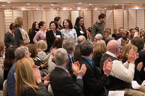 The crowd applauds the 10-year honorees.
