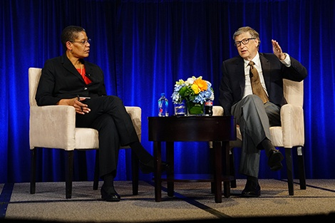 Michelle Williams and Bill Gates on stage, talking