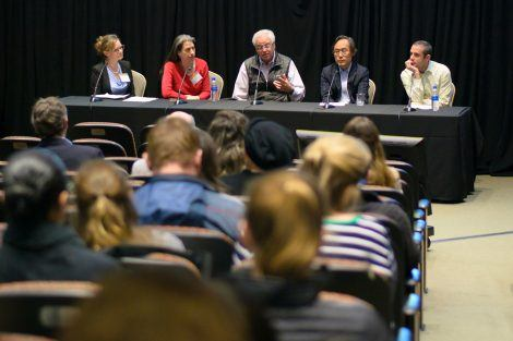 a picture of a panel discussion.