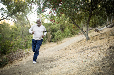 Photo of man jogging in woods