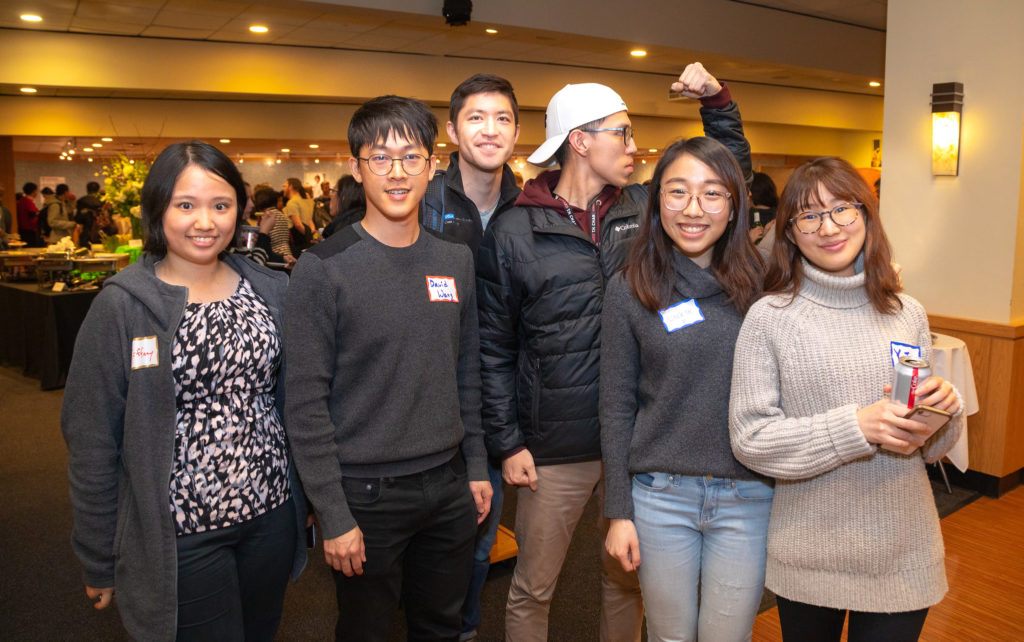 Students pose at reception