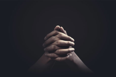 hands clasped, as if in prayer