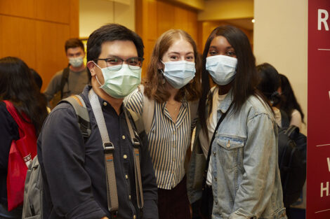 A trio of new students posed in the Kresge building