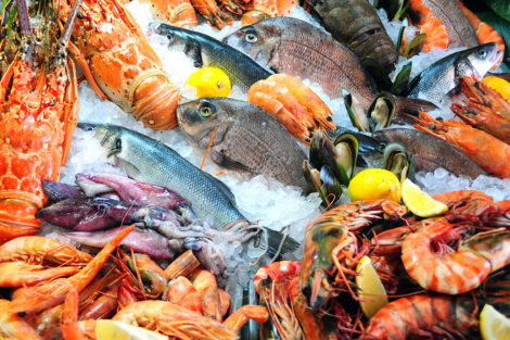 a platter of fish, lobsters, and other aquatic food