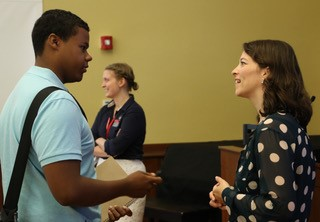 Dr. Claudia Trudel-Fitzgerald and student having a conversation