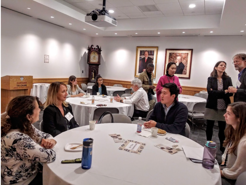 Students, scholars, and faculty meeting with leaders in field at breakfast roundtable