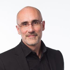 headshot of Dr. Arthur Brooks