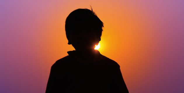 Child in front of sun