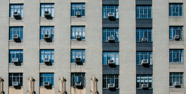 air conditioners installed on an apartment building