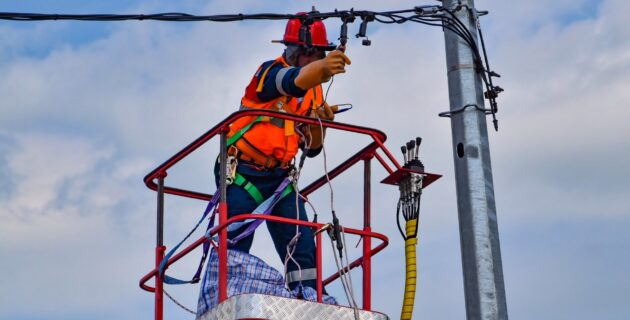 Electrician repairing a power line