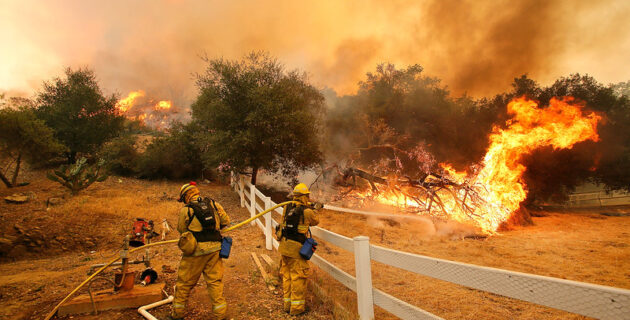 Firefighters battle a wildfire in California