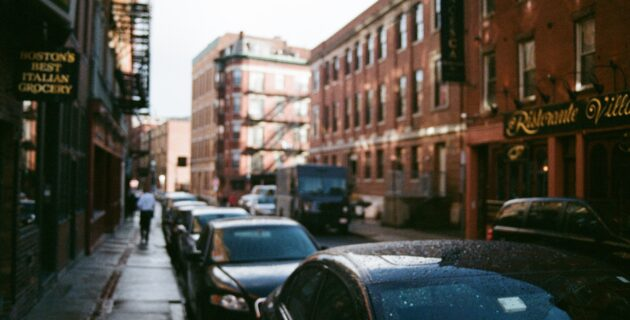 A long row of cars parked in Boston